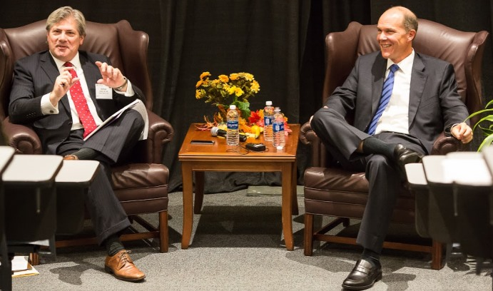 Michael J. Connor '80 '14P (left) moderates a fireside chat with Jordan Hitch '88, senior adviser to Bain Capital, who gave the keynote presentation at the Wall Street Council's tenth annual Financial Services Forum.