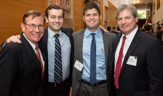 Father-son duos (from left) David D. Beard '80 '11P and David A. Beard '11, and Sean Connor '14 and Michael Connor '80 '14P at WSC's Financial Services Forum. Uncle/nephew legacies Andrew Fife '85 and Michael Fife '12 also attended the event.