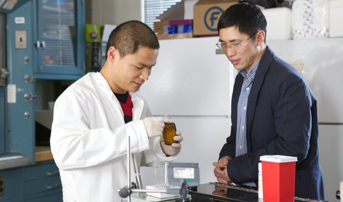The testing and diagnostic tools developed by Yaling Liu (at right, with Ph.D. candidate Wentao Shi) enable the early detection of cancer and evaluate the targeted delivery of medicine. (Photo by Elaine Zelker)