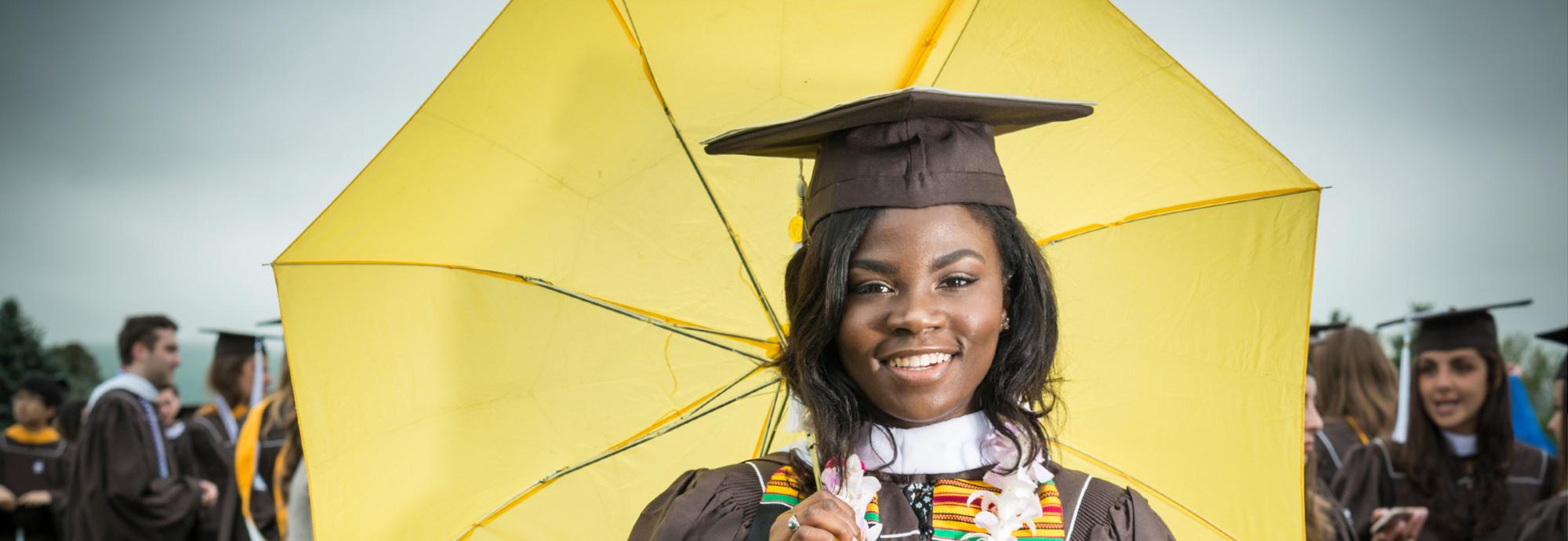 Graduate with an umbrella