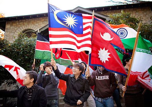 Students holding world flags