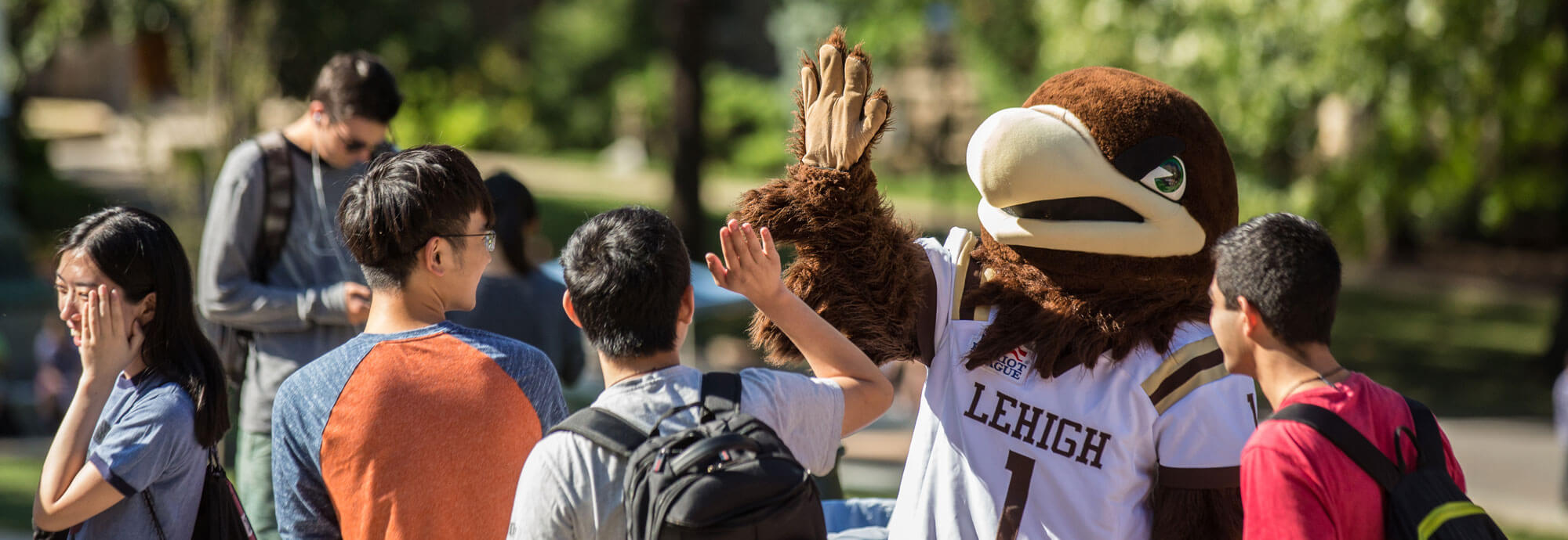 Lehigh mountainhawk mascot, Clutch, high-fives student