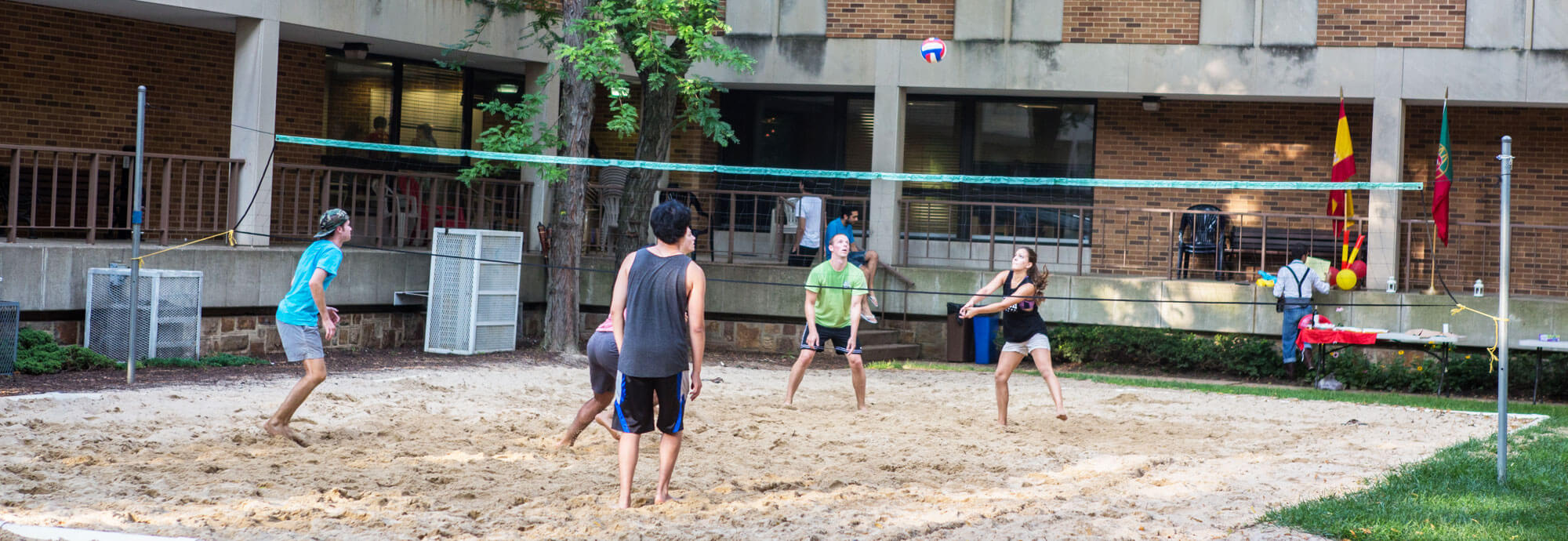 LU students playing sand volleyball on campus