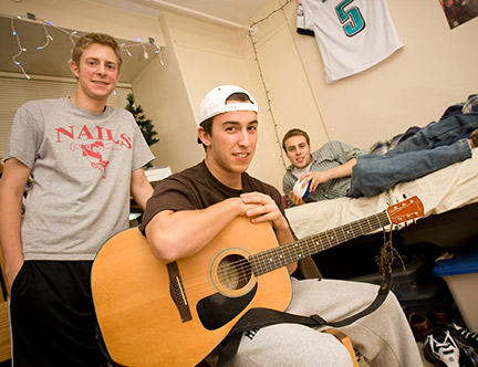 Three male students in a residence hall