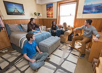 A group of students in a suite housing room