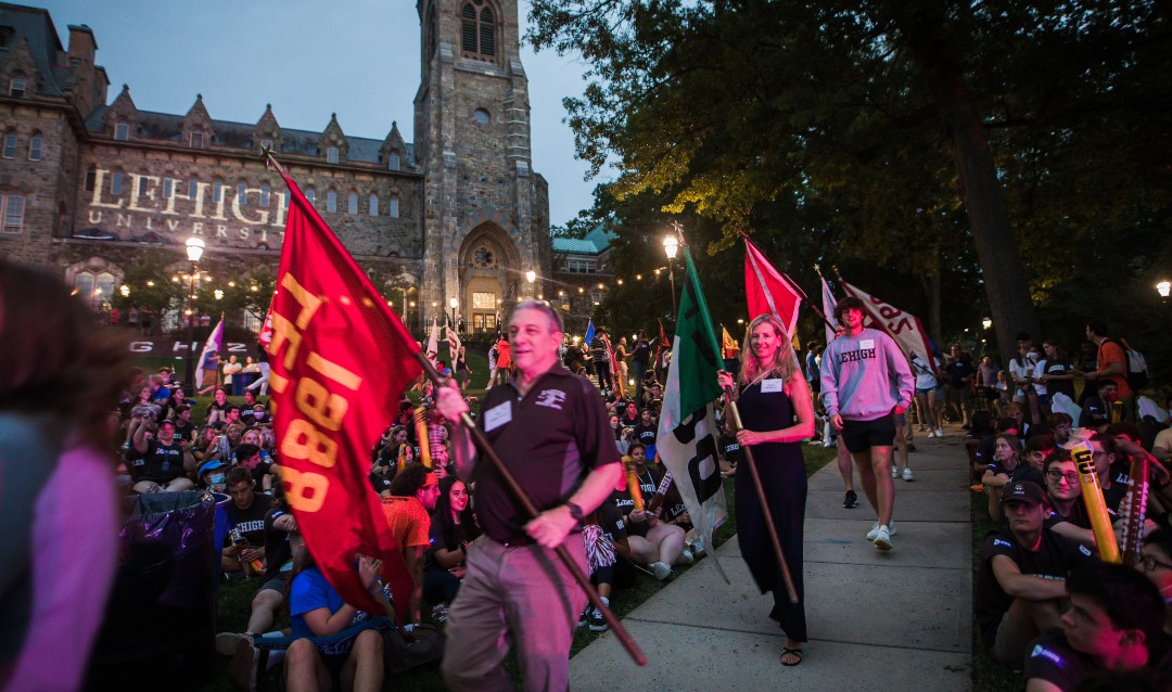The Rally 2021 with alumni carrying class flags