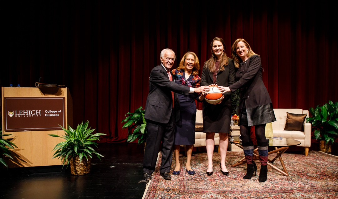 Donald M. Gruhn; Georgette Chapman Phillips, Kevin L. '84 '13P and Lisa A. '13P Clayton Dean of the College of Business; Mary Clougherty; and Cathy Engelbert stand together on stage holding a basketball at Lehigh University