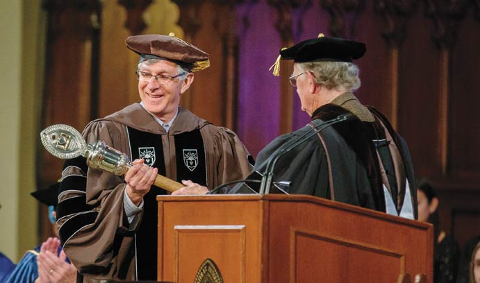 James McIntosh, right, professor of sociology, hands John D. Simon the university mace, or academic scepter, at his installation as Lehigh's 14th president.