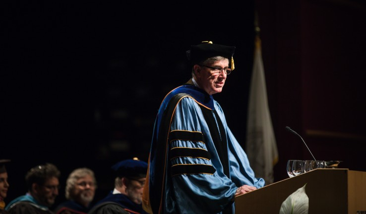 Lehigh University provost Patrick Farrell speaking at an event wearing academic regalia.