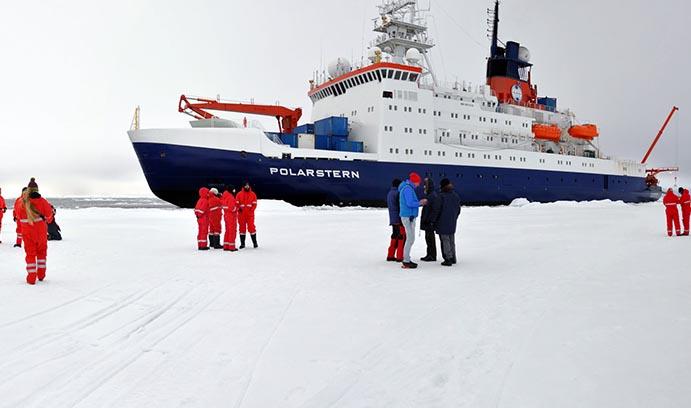 Jill McDermott next to the Polarstern in the Arctic