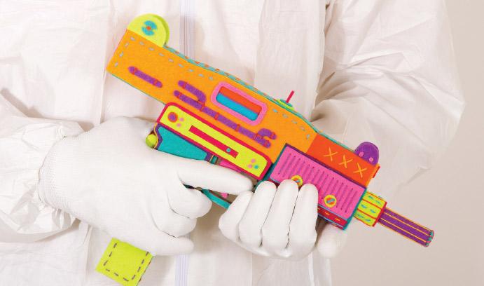 Person holding a multi-colored gun