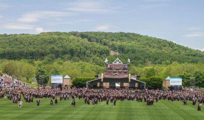 Lehigh University graduates on football field during commencement