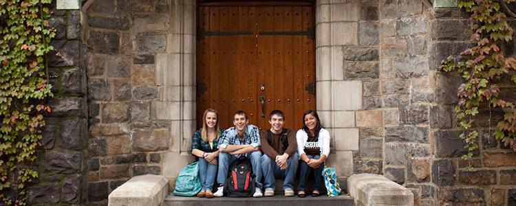 Four Lehigh students sitting outside Packer Memorial Church