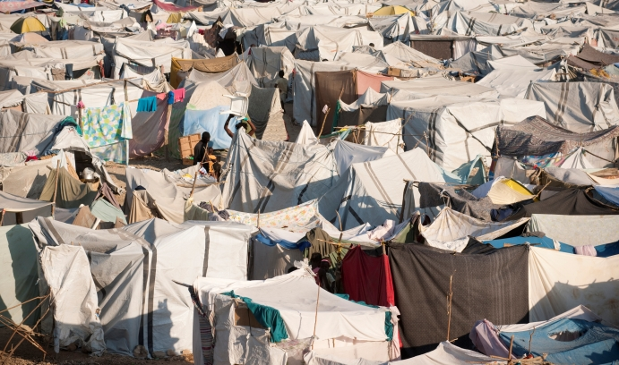A camp in Haiti temporarily housed people displaced by a major earthquake in 2010. According to Amnesty International, 123 camps were housing displaced 85,432 people in Haiti in September 2014. (Photo by iStock/Claudia Dewald)