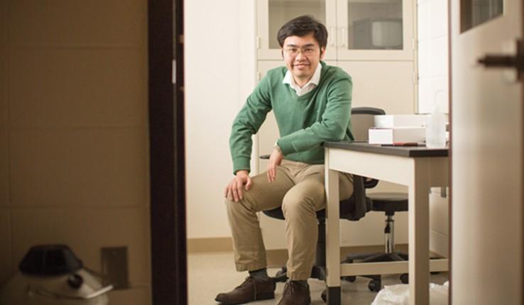 Xiaoji Xu sitting at a table
