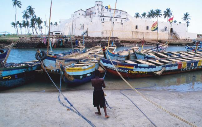 Lehigh history professor Kwame Essien grew up near the Elmina slave fort (background) in Ghana. Essien has spent two decades studying African migration and the slave trade.