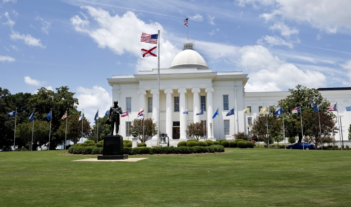 The state capitol building in Montgomery, Alabama. The state's governor, Robert J. Bentley, turned down an expansion of federal Medicaid funding provided by the Affordable Care Act. (Photo courtesy of iStock/mj0007)