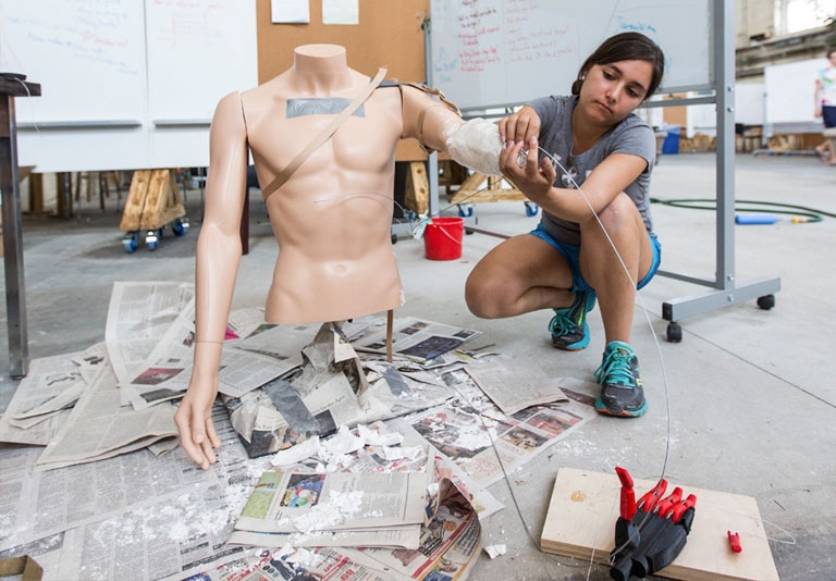 Student working with a human body model