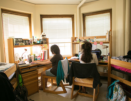 Two students in a residence hall